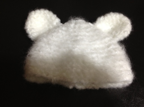 Crocheted polar bear baby hat pattern